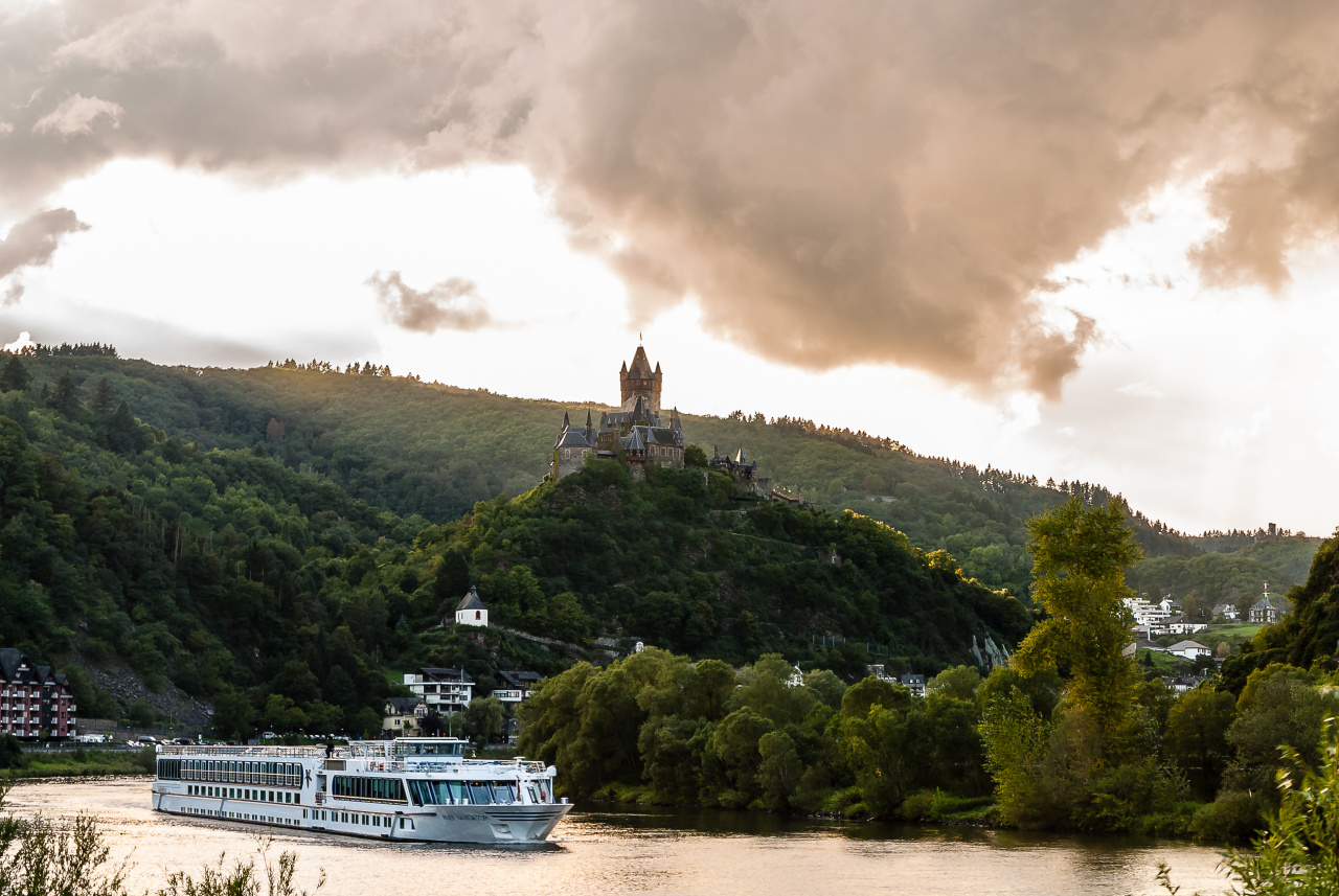 the Reichsburg at the river Mosel in Cochem, Germany at sunset.